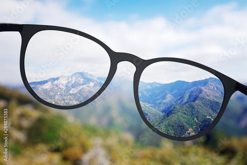 Slika na platnu Bright nature though eyeglasses