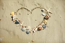 View Of Drawn Love Heart Symbol On Sand Beach
