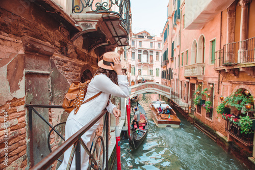 woman looking at canal with gandola Canvas