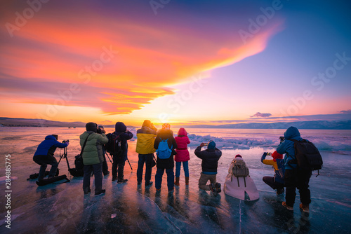 Foto auf Gartenposter Koralle Photographers or Travellers using a professional DSLR camera take photo beautiful landscape of Baikal lake at sunset winter, Rusia - Recreation and outdoor travel concept.