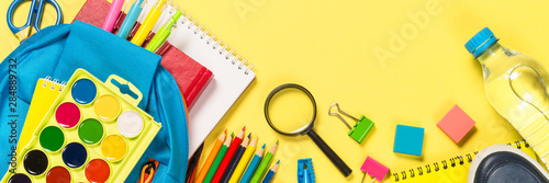 Poster de jardin Montagne School backpack with stationery on yellow background.