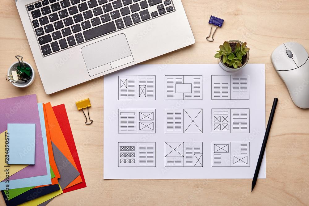 Fototapeta Editorial designer desk with publication layout
