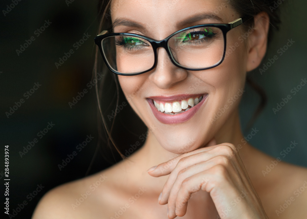 Fototapeta Close up photo of a smiling woman in eyeglasses.