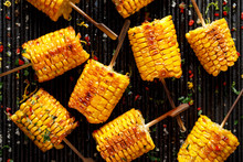 Grilled Corn On The Cob With Butter And  Salt  On The Grill Plate, Top View