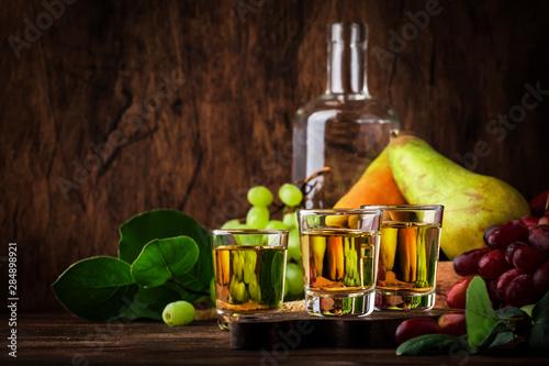 Rakija, raki or rakia - Balkan hard alcoholic drink or brandy from fermented fru Fototapete
