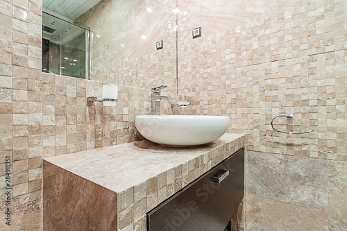 Stampa su Tela Interior of a modern pastel pink beige color bathroom, tiled mosaic walls and wh