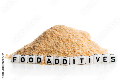 Concept showing appearance of the food additives in the everyday fastfood Fototapeta