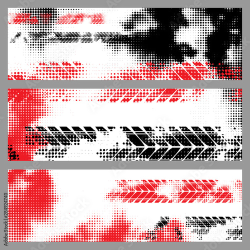 Black halftone tire track silhouettes isolated on gray background Wall mural