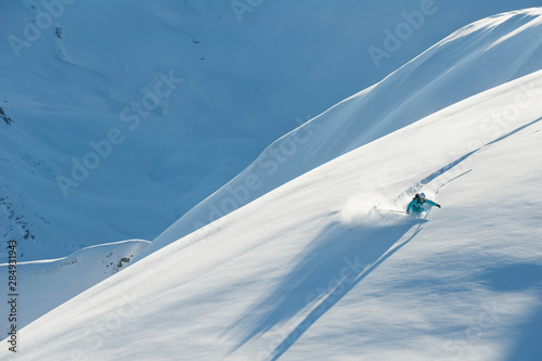 Austria, Woman skiing on snow covered arlberg mountain