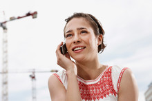 Germany, Berlin, Young Woman Using Mobile Phone, Portrait, Close-up