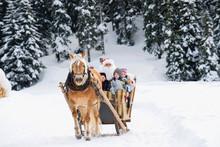 Italy, South Tyrol, Seiseralm, Santa Claus And Children Taking A Sleigh Ride