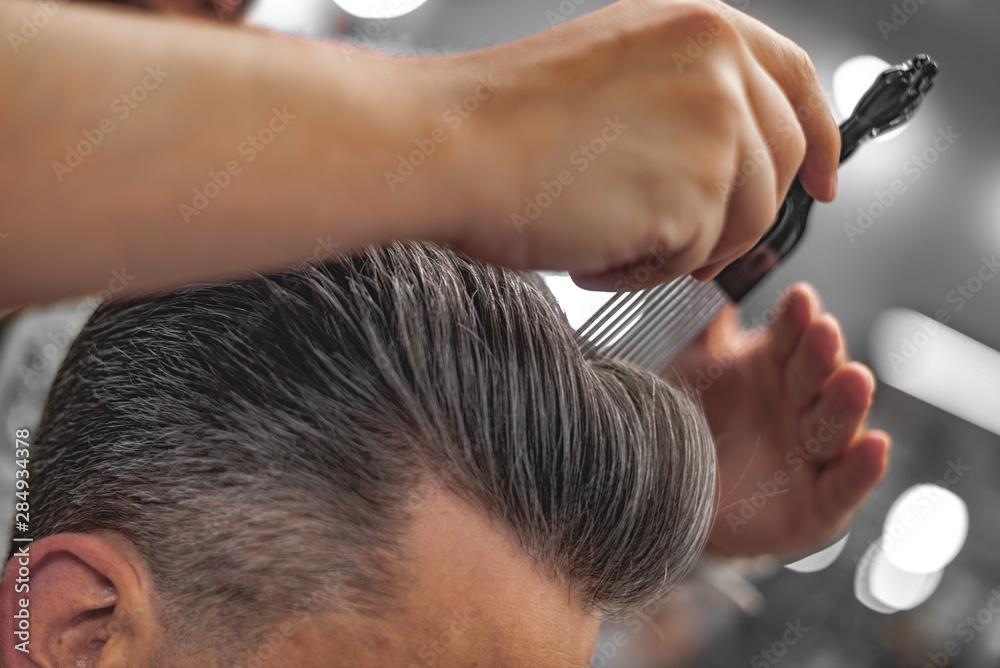 Fototapety, obrazy: Barber does hair styling. Men's Hair Care.