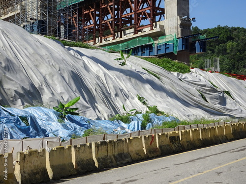 Stampa su Tela Temporary slope protection during construction using the plastic sheets to prevent soil erosion by rainwater