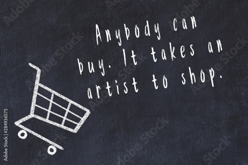 Photo Chalk drawing of shopping cart and short quote about shopping on black board