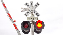 CLOSE UP: Railway Crossing Sign With Flashing Red Lights And Gates Closing