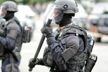 Police Officer In Riot Gear Ov...