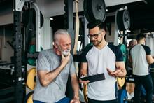 Senior Man Exercising In Gym W...