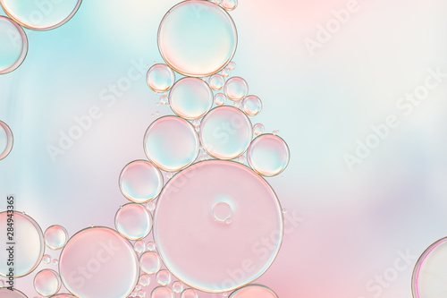 Leinwand Poster Bright and unique oil drops, circles on the water surface