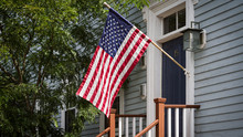 American Flag In Front Of A Bu...