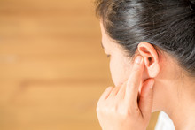 Female Having Ear Pain Touching His Painful Head