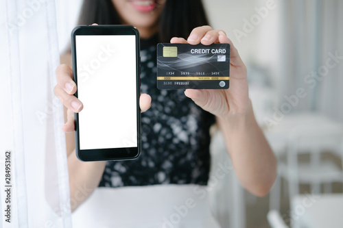 Fototapety, obrazy: Mockup image of Beautiful woman holding credit card shopping online with smartphone on online websites, mockup concept