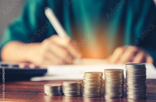 Fototapeta  money coin on each line rising team businessmen background - business saving money concept. obraz