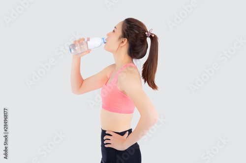 Cuadros en Lienzo Beautiful young asian woman fit shape drinking water after workout and exercise isolated on white background, girl thirsty after aerobic tired for refresh, model fitness healthy and wellness concept