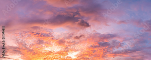 Foto auf Leinwand Koralle Dramatic vibrant color with beautiful cloud of sunrise and sunset on a cloudy day. Panoramic image.