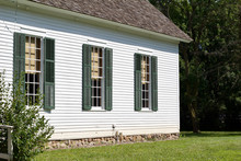 Exterior View Of A 19th Century One Room Country Schoolhouse With Windows