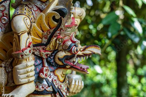 Cuadros en Lienzo Balinese ancient colorful bird god Garuda with wings, closeup