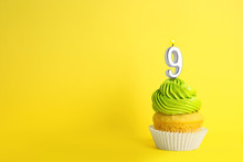 Birthday Cupcake With Number Nine Candle On Yellow Background, Space For Text