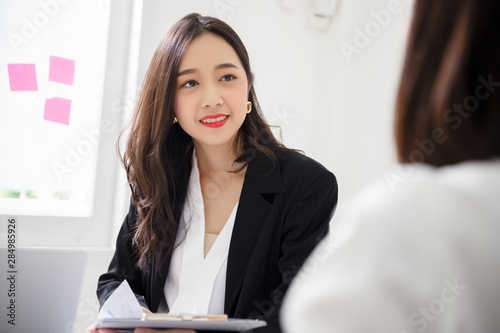 Pinturas sobre lienzo  A young attractive asian woman is interviewing for a job