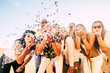 Leinwandbild Motiv Happiness and joyful concept - group of happy women people celebrate. all together blowing confetti and having fun - new year eve and party event for group of beautiful girls -white clear  background