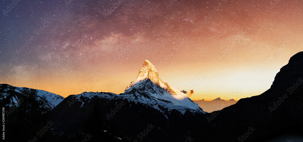 Fototapeta Swiss Alps, Panoramic Matterhorn mountain in sunrise with starry sky in dawn