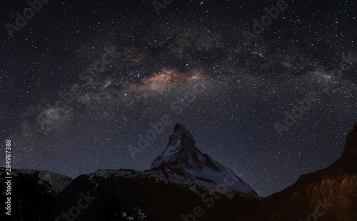 Panoramic Matterhorn mountain at night in Switzerland with starry sky and milky Wallpaper Mural
