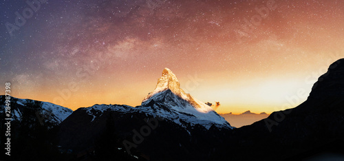 Photo Swiss Alps, Panoramic Matterhorn mountain in sunrise with starry sky in dawn