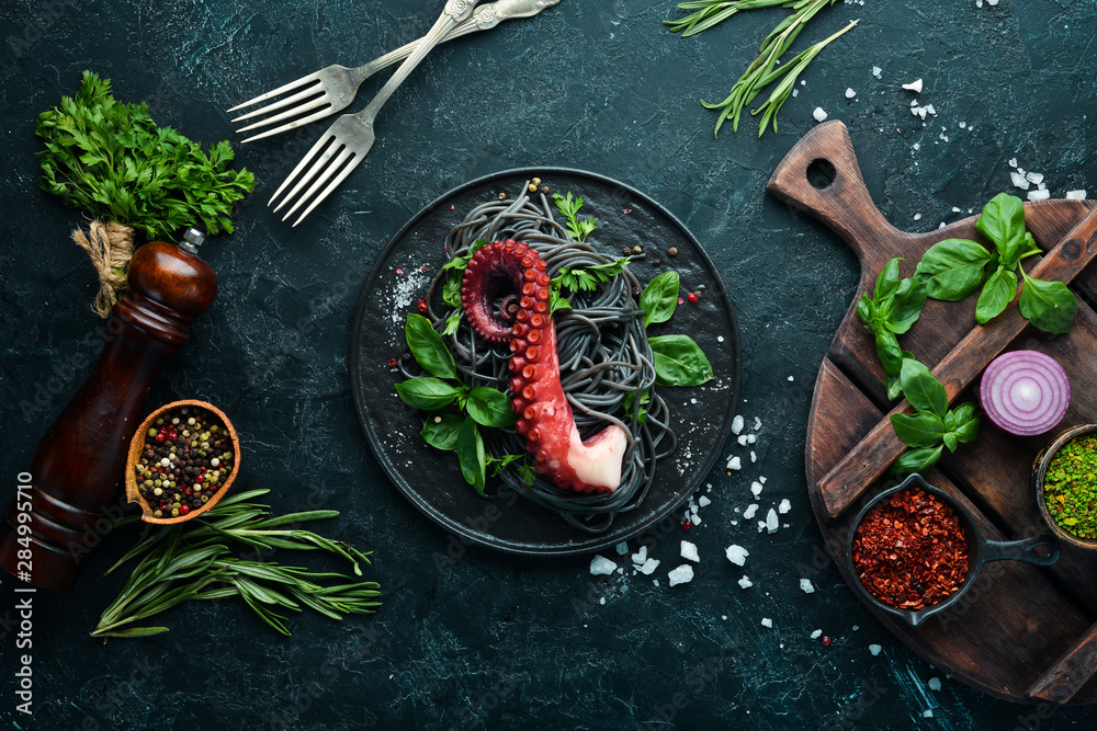 Fototapety, obrazy: Black pasta with octopus tentacles. Seafood on a stone plate. In the old background. Top view. Free copy space.