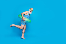 Full Length Photo Of Cheerful Retired Person With Eyeglasses Eyewear White Hair Holding Toy Ring Wearing Striped Bathing Suit Isolated Over Blue Background