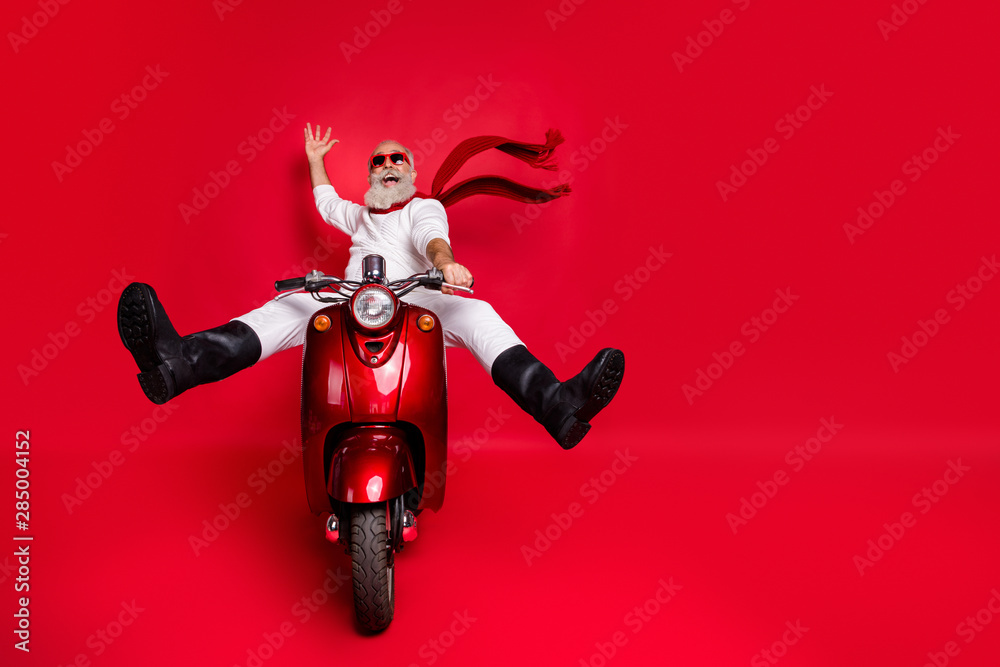 Fototapety, obrazy: Full size photo of funny pensioner with eyeglasses eyewear raising his palm screaming driving his bike wearing white jumper trousers pants boots isolated over red background