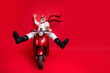 Full size photo of funny pensioner with eyeglasses eyewear raising his palm screaming driving his bike wearing white jumper trousers pants boots isolated over red background