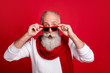 canvas print picture - Cool aged santa man read xmas sale prices not believe eyes wear sun specs knitted jumper isolated red background