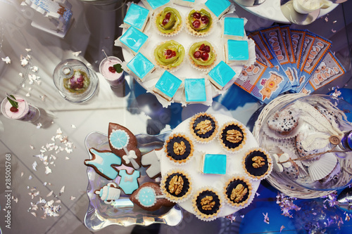 Sweet table. A plates of cakes and muffins, sweets, candys