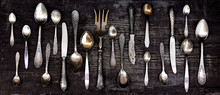 Vintage Cutlery - Spoons, Forks And Knives On An Old Wooden Background.