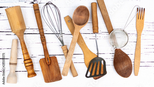 Vintage old kitchen utensils on a white wooden background. Wallpaper Mural