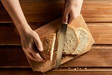 Male Hands Cut Fresh Wheat Bre...