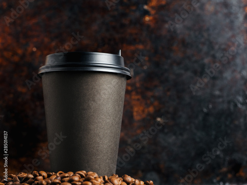 A Cup of coffee on a rusty old dark background with copyspace