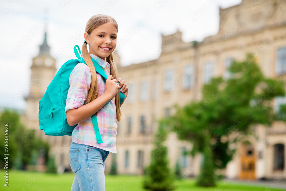 Fototapety, obrazy: Profile side photo of lovely child looking with toothy smile wearing plaid checkered shirt standing outdoors