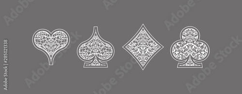Set 4 aces Playing card suits icons decoration pattern: diamonds, clovers, hearts spades template on gray background Wallpaper Mural