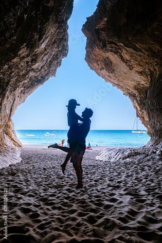 Caves of Cala Luna beach Sardinia Orosei coast, couple on the beach of Cala Luna Wall mural