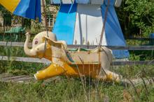 Old Abandoned Elephant Carousel. Sunny Summer Day.